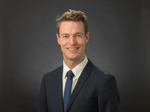 Executive on dark grey background